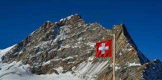 Swiss flag against top of Jungfrau stock image