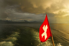 Swiss flag on boat. Lake Leman Royalty Free Stock Images