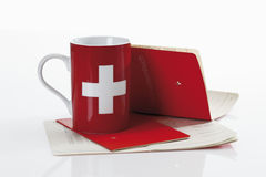 Swiss  flag cups with bank book on white background Royalty Free Stock Photo