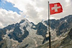 Swiss flag with Dolent glacier in Swiss Alps Royalty Free Stock Image