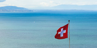 Swiss flag floating in the wind Stock Photos