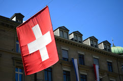 Swiss flag hanging in Zurich Royalty Free Stock Image