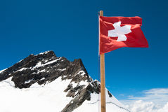 Swiss Flag and Jungfrau Royalty Free Stock Photo