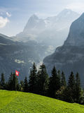 Swiss flag in the mountains Stock Photo