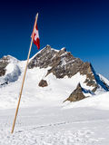 Swiss flag in the mountains Royalty Free Stock Images