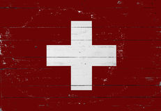 Swiss flag painted on a wooden board Royalty Free Stock Photography