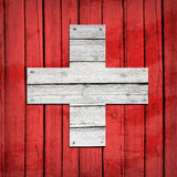 Swiss flag painted on wooden boards Stock Photos