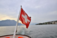 Swiss flag at rear of cruise ship in Lake Lucerne Royalty Free Stock Image