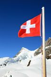 Swiss flag at the snow fields of the Jungfrau Royalty Free Stock Image