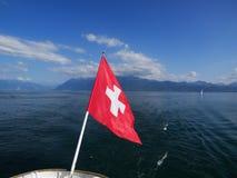 Swiss Flag Symbol On Lake Geneva, Switzerland Stock Images