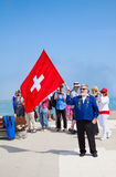 Swiss flag thrower Royalty Free Stock Photo