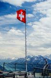 Swiss flag on the top Stock Photos