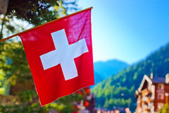 Swiss flag. On town background Royalty Free Stock Images