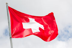 Swiss flag waving on the wind Stock Images