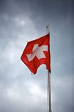 Swiss Flag waving in the Wind Stock Images