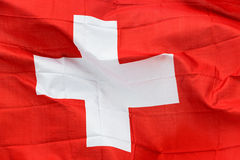 Swiss flag in the wind in the sunshine Royalty Free Stock Photos