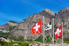 Swiss flags on San Bernardino pass Royalty Free Stock Photography