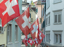 Swiss Flags in a Zurich street Royalty Free Stock Photo