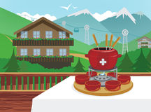 Swiss fondue. Traditional Swiss fondue. Alpine mountain resort on background Stock Photos