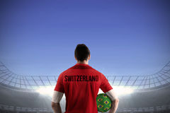 Swiss football player holding ball Royalty Free Stock Photo