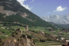 Swiss fortified Village. The fortified village of Saillon in the Swiss Alps surroundsed by vineyards and mountains Stock Photo