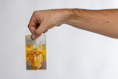 Swiss Franc Banknote in hand Royalty Free Stock Photo