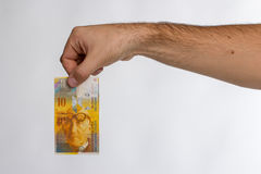Swiss Franc Banknote in hand Royalty Free Stock Photos