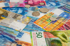 Swiss franc banknotes and coins as background Stock Image