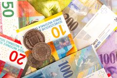 Swiss Franc Bills and Coins. From value 1 to 1000 mixed over Royalty Free Stock Images