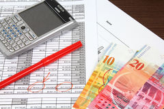 Swiss franc business. Business objects. Financial analysis - income statement, finance graphs, generic smart phone and Swiss franc currency