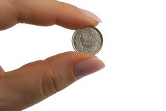 Swiss franc coin centime. Single centime hold between two fingers Royalty Free Stock Photo