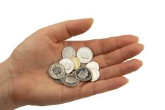 Swiss franc coins. Various swiss franc coins hold in open hand Stock Photos