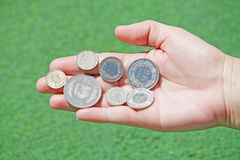 Swiss franc coins hold in open hand Royalty Free Stock Photos