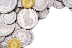 Swiss Franc Coins with White Copy Space On Right Side. A pile of current, legal tender Swiss Francs (CHF) with white copy space on the right side for Stock Photos