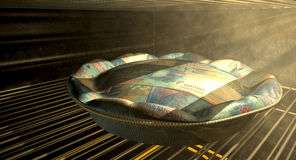 Swiss Franc Money Pie Baking In The Oven Stock Photo