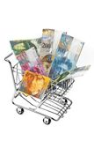 Swiss Franc Money with shopping basket. Currency Swiss Franc notes in a shopping cart Stock Photos