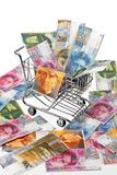 Swiss Franc Money with shopping basket. Currency Swiss Franc notes in a shopping cart Royalty Free Stock Images