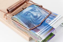 Swiss Franc in mousetrap Stock Photo
