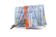 Swiss Franc note and Key To Success With Red Bow Stock Image