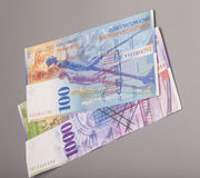 Swiss 1000 and 100 Franc notes. Isolated on gray Royalty Free Stock Photo