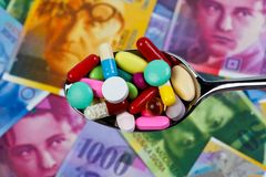 Swiss Franc and tablets. As a symbol of health costs Stock Images