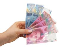 Swiss Francs. Banknotes hold in female hand Royalty Free Stock Photos