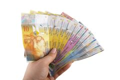 Swiss Francs banknotes. Hold in female hand Royalty Free Stock Images