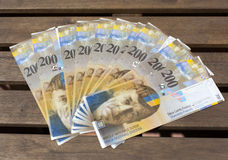 Swiss Francs, denomination of  200 on a wooden background.  Royalty Free Stock Images