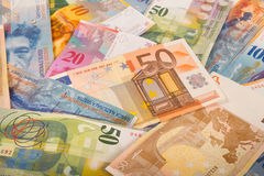Swiss francs and euro banknotes Royalty Free Stock Photos