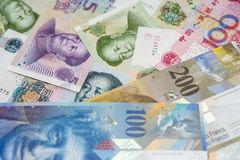 Swiss Francs notes and Chinese Yuan Royalty Free Stock Photos