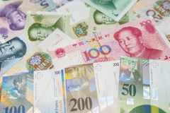 Swiss Francs notes and Chinese Yuan. Royalty Free Stock Image