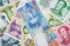 Swiss Francs notes and Chinese Yuan. Stock Photos