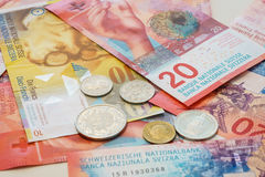 Swiss Francs notes and coins with New twenty Swiss Franc bills. Royalty Free Stock Photo