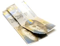 Swiss francs on white Stock Image